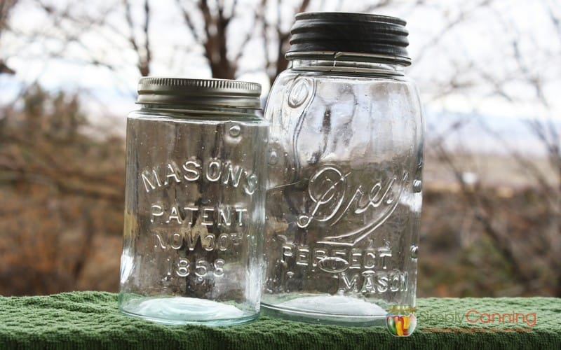 Clear antique canning jars with bubbles in their glass.
