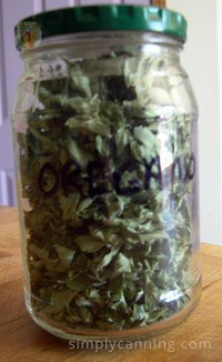 A closed jar filled with dried oregano leaves and labeled accordingly.