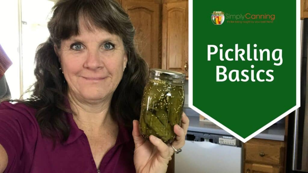 Sharon holding a jar of cucumber pickles.