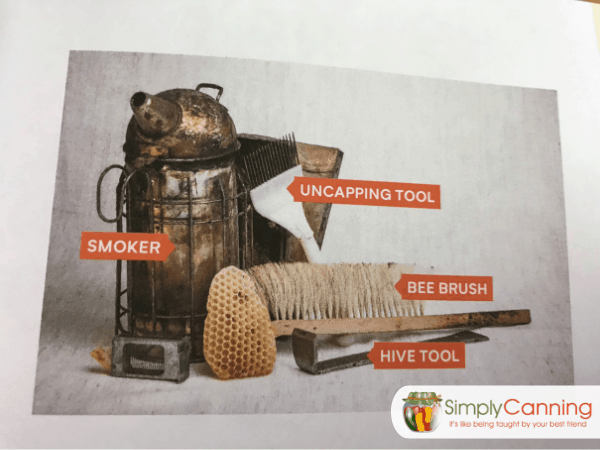 Smoker, uncapping tool, bee brush, and hive tool.