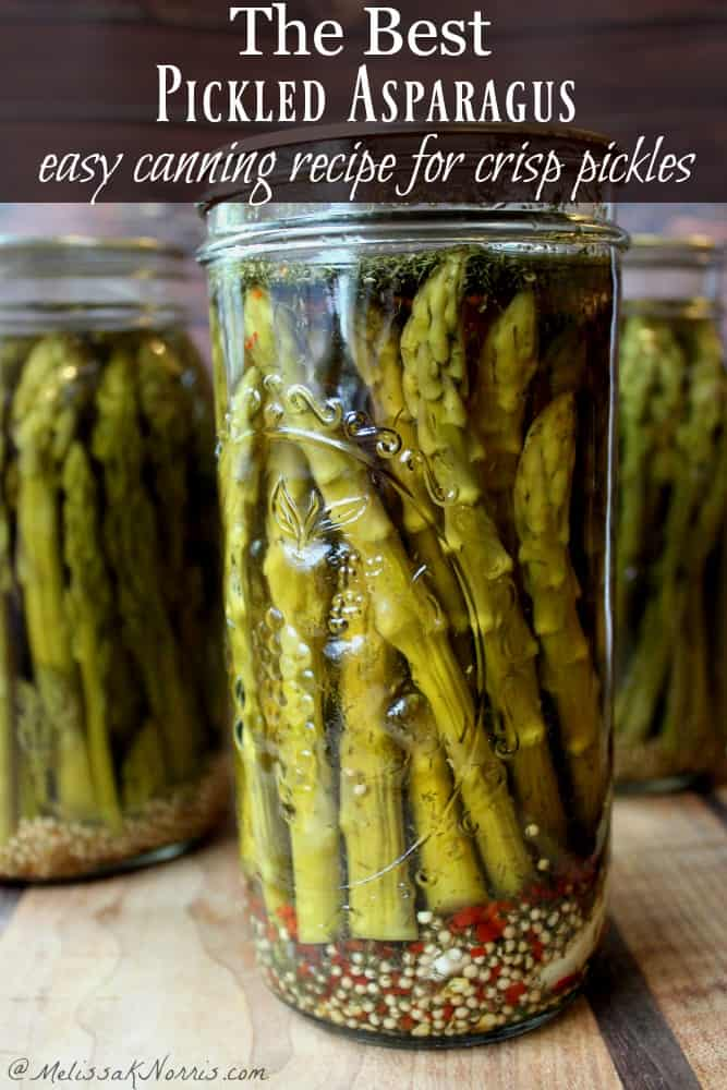 A jar of bright green pickled asparagus spears.