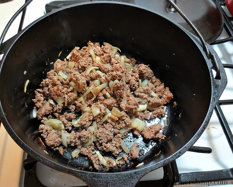 Browning meat and onions in a cast iron Dutch oven.