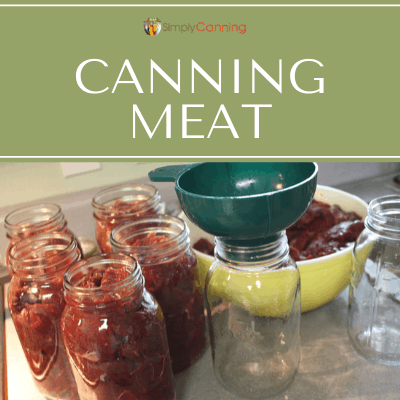 Filling jars with raw meat pieces.