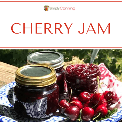 Richly colored cherry jam in cute little canning jars.