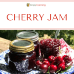 Cherry Jam arrangement of jars and cherries.