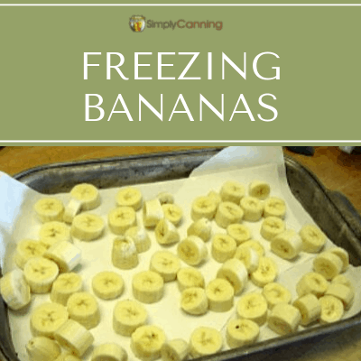 Thick banana slices in a tray covered with parchment paper.