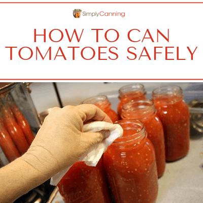 Wiping rims clean on jars filled with tomatoes.