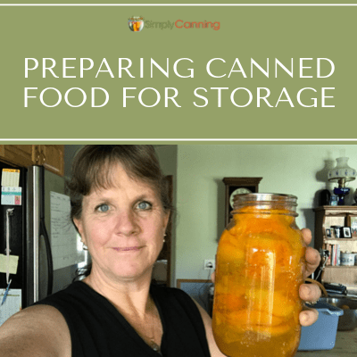 Sharon holding a jar of canned fruit.