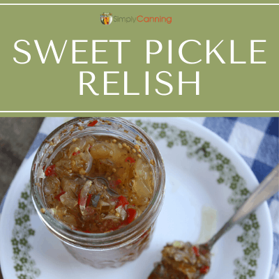 Looking down into an open jar of green and red sweet pickle relish.