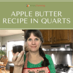 Sharon holding a tiny jar of canned apple butter.