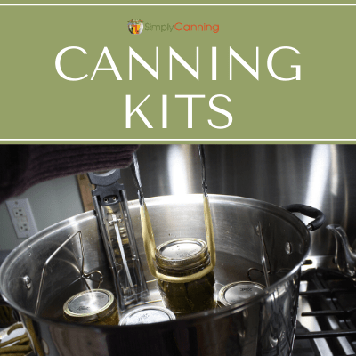 Jar lifting tool in action, just one of the things included in a canning kit!
