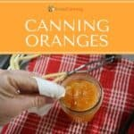 Wiping the rim of a jar that's filled with orange segments.