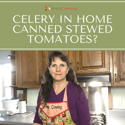 Sharon standing in her kitchen and wearing a red Simply Canning apron.