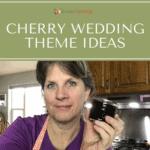 Sharon holding a jar of dark cherry jam.