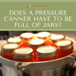 Filled canning jars in a pressure canner.