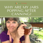 Sharon pressing down on sealed canning jar lid.