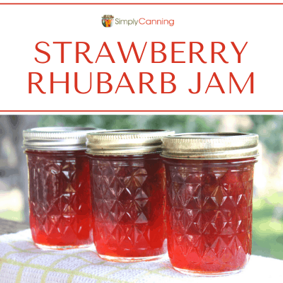 Bright red strawberry rhubarb jam in canning jars.