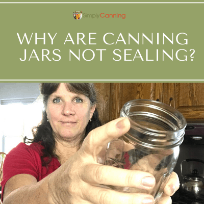 Sharon holding a canning jar.