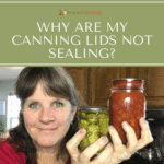 Sharon holding jars of pickles and another home canned product.