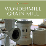 Two different types of Wondermill grain mills sitting beside each other on the countertop.