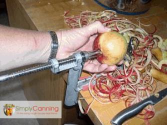 Using the apple slicer peeler.