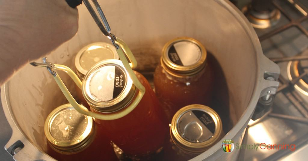 Jars of homemade broth in a pressure canner.