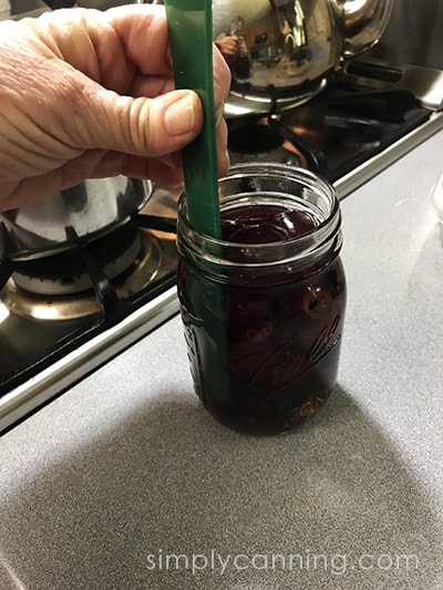 Canning Cherries - removing bubbles.