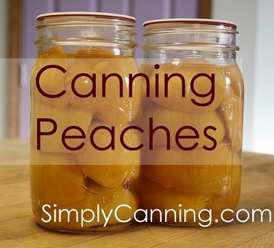 Two quart jars filled with peach halves.