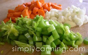 Chopped carrots, onion, and celery for making homemade chicken soup.