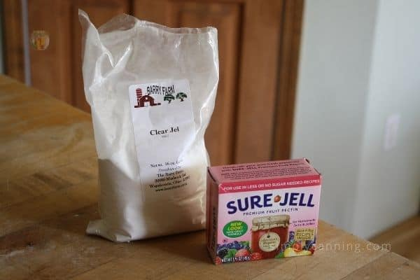 A package of Clear Jel sitting next to a package of Sure Jell.