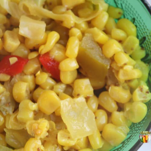 Colorful mixture of corn relish in a deep green dish.