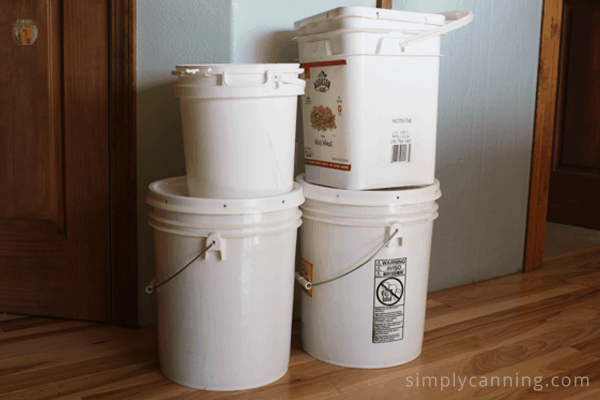 Round and square buckets of various sizes with lids.