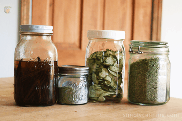 Various glass jars filled with dried and shelf stable food.