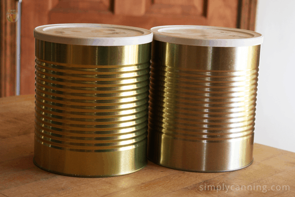 Metal cans with plastic lids on top.