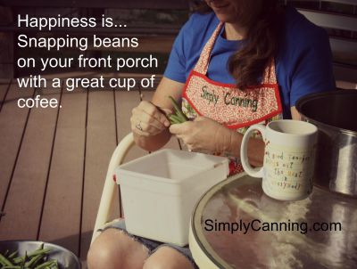 Sharon snapping beans on the porch with a cup of coffee next to her.