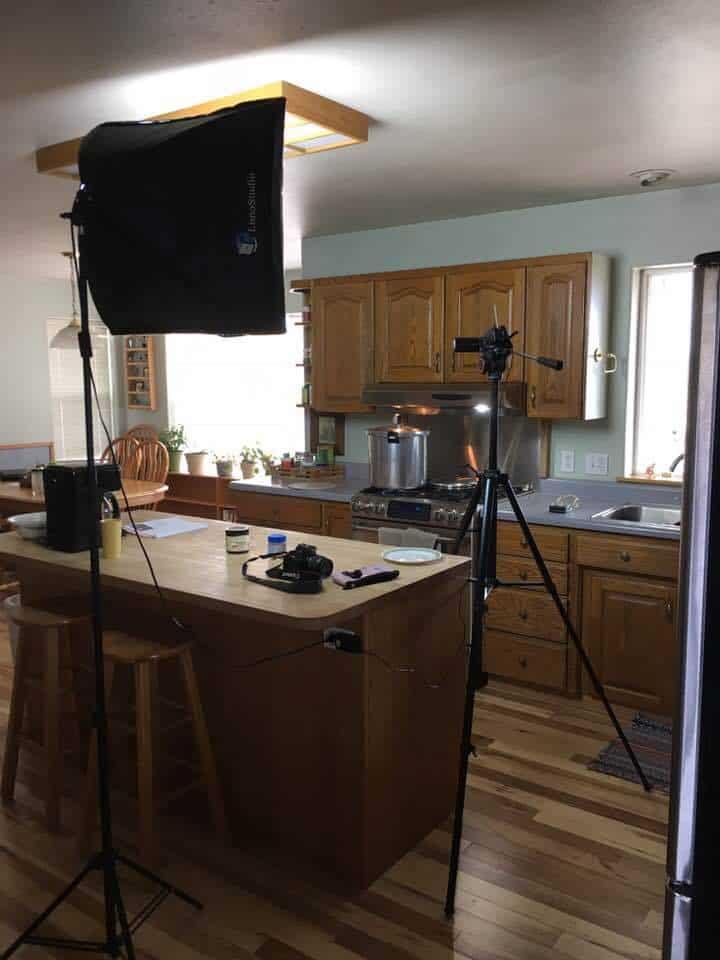 Sharon's kitchen setup with lights and camera on a tripod.