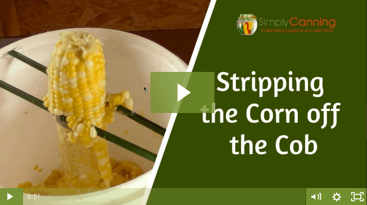 members stripping the corn off the cob