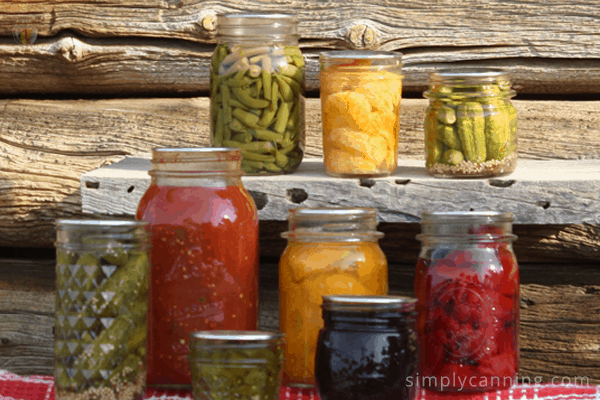 Green beans, fruit, pickles, and more in canning jars of various sizes.