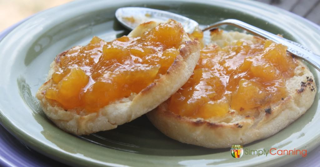 Peach jam spread over toasted English muffins.
