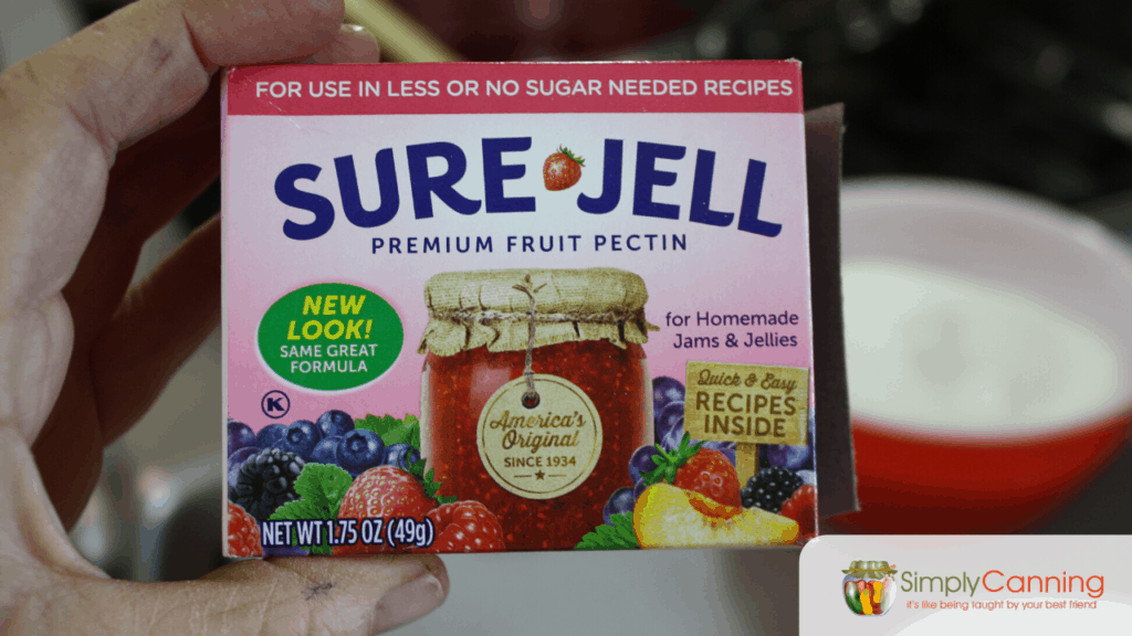 Package of SureJell Premium Fruit Pectin that is illustrated with a canning jar on the front.