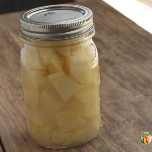 A jar of home canned potato chunks.
