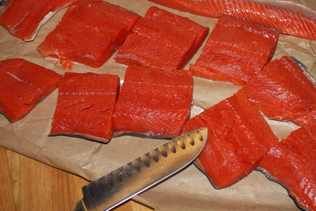 Drying off pieces of salmon.