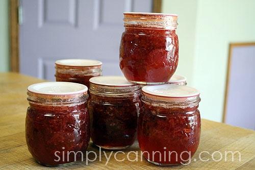 Decorator jars of strawberry jam.